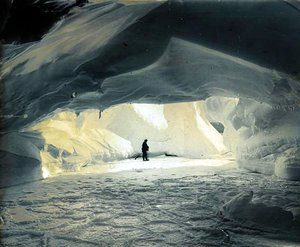 Ice cave, frozen sea and pancake ice foreground